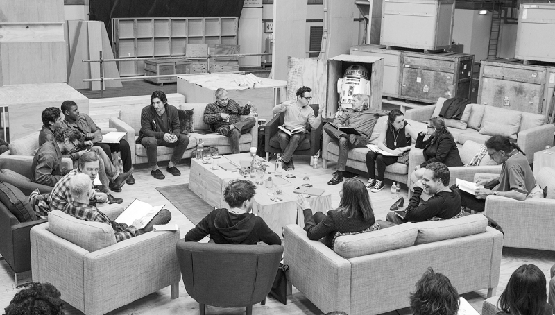 April 29th, Pinewood Studios, UK – Writer/Director/Producer J.J Abrams (top center right) at the cast read-through of Star Wars Episode VII at Pinewood Studios with (clockwise from right) Harrison Ford, Daisy Ridley, Carrie Fisher, Peter Mayhew, Producer Bryan Burk, Lucasfilm President and Producer Kathleen Kennedy, Domhnall Gleeson, Anthony Daniels, Mark Hamill, Andy Serkis, Oscar Isaac, John Boyega, Adam Driver and Writer Lawrence Kasdan. Copyright and Photo Credit: David James.